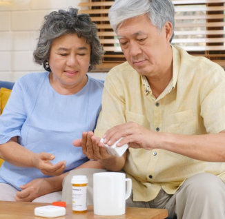 Senior asian couple take pill medicine for elderly healthy