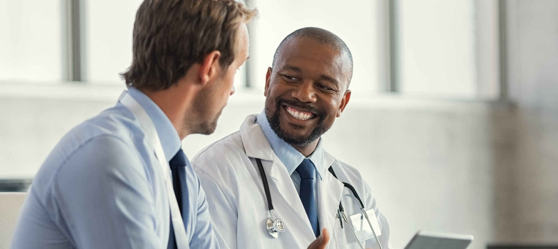 doctor smiling to his patient