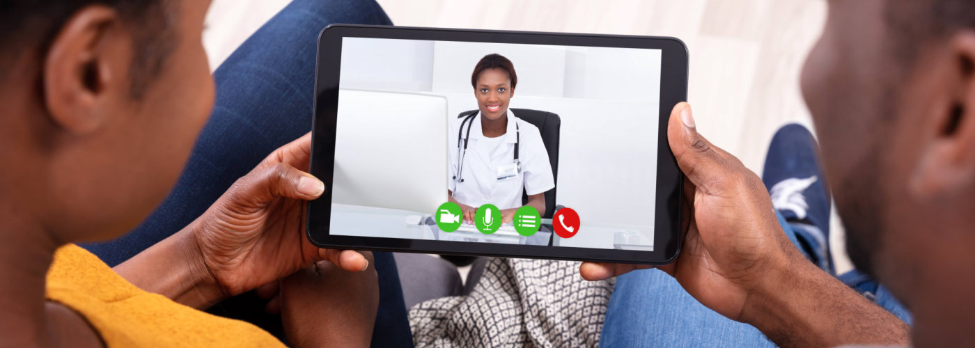 couple video calling with their doctor