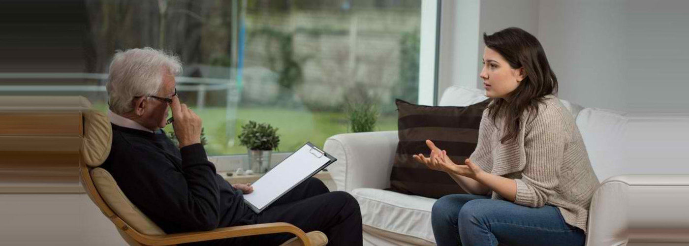 woman talking to a therapist